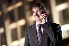 Happy businessman talking on cell phone Royalty Free Stock Photos