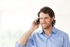 Happy businessman talking on cell phone Stock Photo