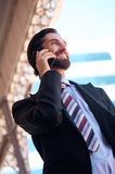Happy businessman talking on cell phone Royalty Free Stock Photography