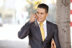 Happy businessman talking at his cellphone Royalty Free Stock Images
