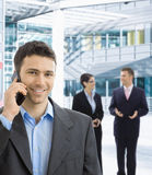 Happy businessman talking on mobile. Portrait of happy businessman talking on mobile in office lobby Stock Images