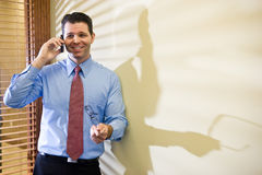 Happy businessman talking on mobile phone Royalty Free Stock Images