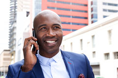 Happy businessman talking on mobile phone. Close up portrait of happy businessman talking on mobile phone Royalty Free Stock Images