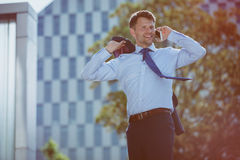 Happy businessman talking on mobile phone Stock Image