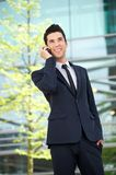 Happy businessman talking on mobile phone outdoors Royalty Free Stock Image