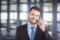 Happy businessman talking on mobile phone Royalty Free Stock Image