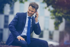 Happy businessman talking on mobile phone Stock Photo