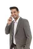 Happy businessman talking on mobile Stock Photos