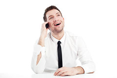 Happy businessman talking by phone. Happy businessman talking by mobile phone smiling. Isolated on white Stock Images