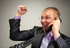 Happy businessman talking by phone Royalty Free Stock Image