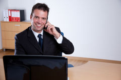 Happy businessman talking on the phone Royalty Free Stock Photo