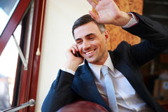 Happy businessman talking on the phone Royalty Free Stock Image