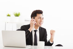 Happy businessman talking on the phone in  office Stock Images