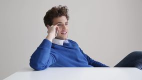 Happy businessman talking on the phone stock footage