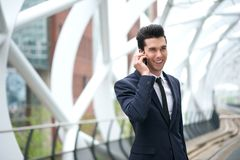 Happy businessman talking on the phone at subway station Royalty Free Stock Images