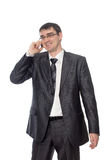 Happy businessman talking on the phone. On a white background Stock Images