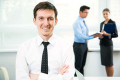 Happy businessman with team Royalty Free Stock Photos