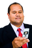 Happy businessman text messaging royalty free stock photography