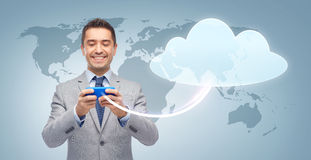 Happy businessman texting message on smartphone Royalty Free Stock Image