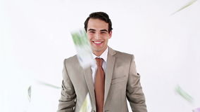 Happy businessman throwing bank notes Stock Photography