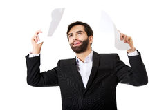 Happy businessman throwing paper sheets. Stock Photo