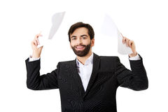 Happy businessman throwing paper sheets. Royalty Free Stock Photos