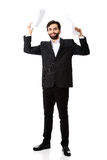 Happy businessman throwing paper sheets. Royalty Free Stock Images
