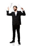 Happy businessman throwing paper sheets. Stock Images