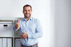 Happy businessman with thumb up Stock Photos
