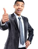 Happy businessman with thumbs up gesture Royalty Free Stock Photography