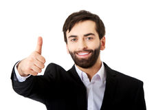 Happy businessman with thumbs up gesture. Royalty Free Stock Image