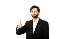 Happy businessman with thumbs up gesture. Stock Photo