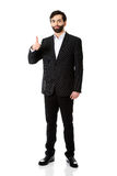 Happy businessman with thumbs up gesture. Royalty Free Stock Photo