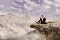 Happy businessman on top of mountain Royalty Free Stock Photos