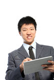 Happy businessman touching a PC tablet Stock Images