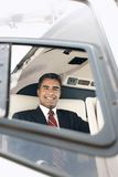 Happy Businessman Travelling Through Helicopter Stock Images