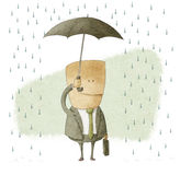 Happy businessman under an umbrella Stock Images
