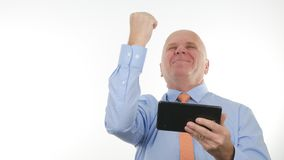 Happy Businessman Use Tablet Read Good Financial News Make Victory Hand Gestures royalty free stock photo