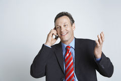 Happy Businessman Using Cell Phone Stock Photo