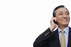 Happy businessman using cell phone over white background Royalty Free Stock Images