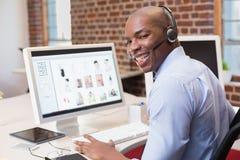 Happy businessman using computer Stock Photos