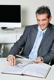 Happy Businessman Using Digital Tablet In Office Stock Image