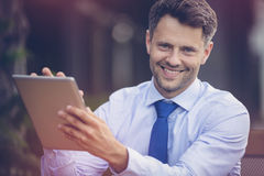 Happy businessman using digital tablet Royalty Free Stock Photography