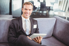 Happy businessman using digital tablet Stock Image