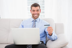 Happy businessman using his laptop Stock Images