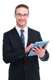 Happy businessman using his tablet pc Stock Photos