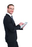 Happy businessman using his tablet pc Royalty Free Stock Photos