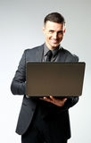 Happy businessman using laptop Royalty Free Stock Photography