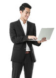Happy Businessman using a laptop Stock Images