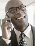 Happy Businessman Using Mobile Phone Royalty Free Stock Images